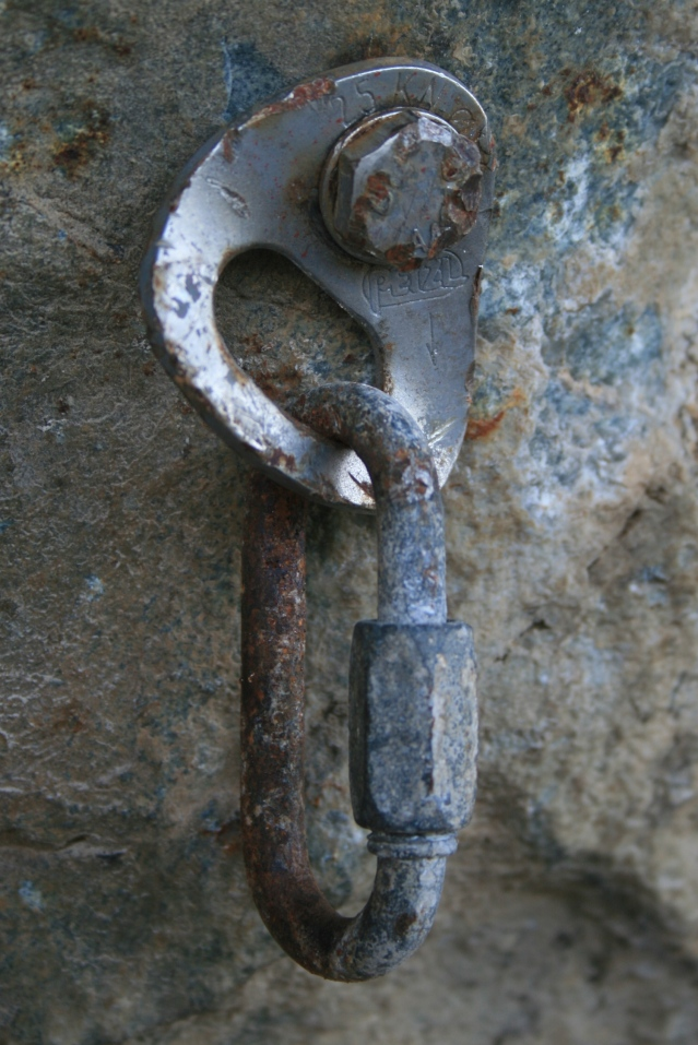Cold and hard: A weathered bold and shackle.