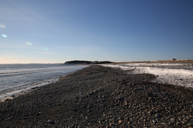 A rocky beach, just outside of Halifax, Nova Scotia. To the right, the snow marks the high tide line.