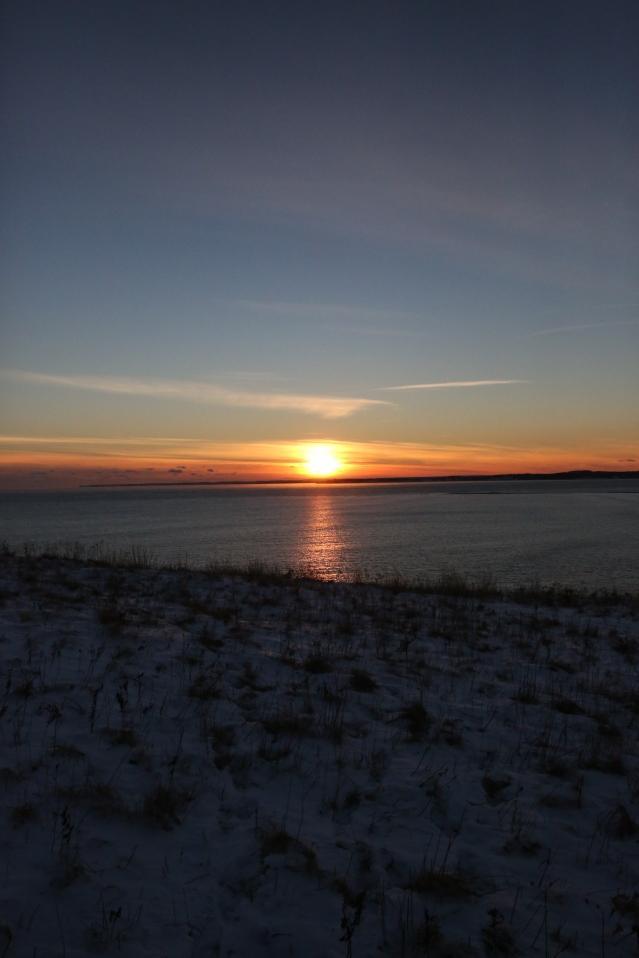 The sun sets over a stretch of water. Nova Scotia, Canada.