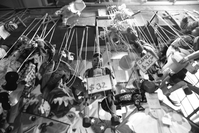 Puppets hanging from the beams. Granville Island, Vancouver.