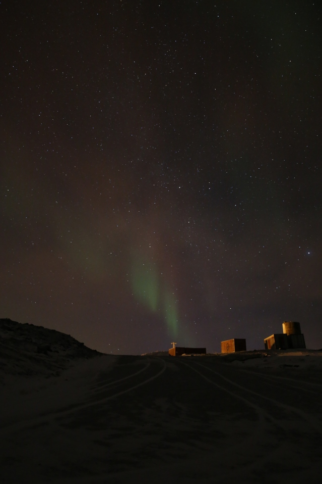 The aurora lights the sky above the hamlet of Ulukhaktok.