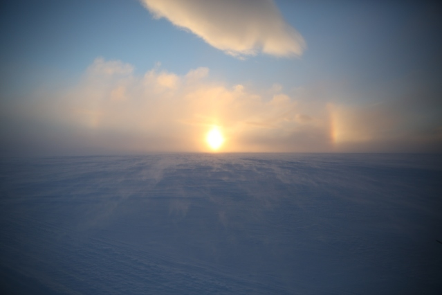The midday sun skirts the horizon of the Canadian arctic. Ulukhaktok, Northwest Territories.