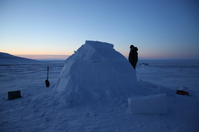 Myself standing with the traditional igloo we built with the help of inuit elder, Robert.