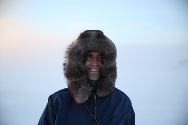Dr Tristan Pearce poses for a photo outside of Ulukhaktok.